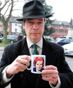 Nigel Farage holding a Thatcher mug.